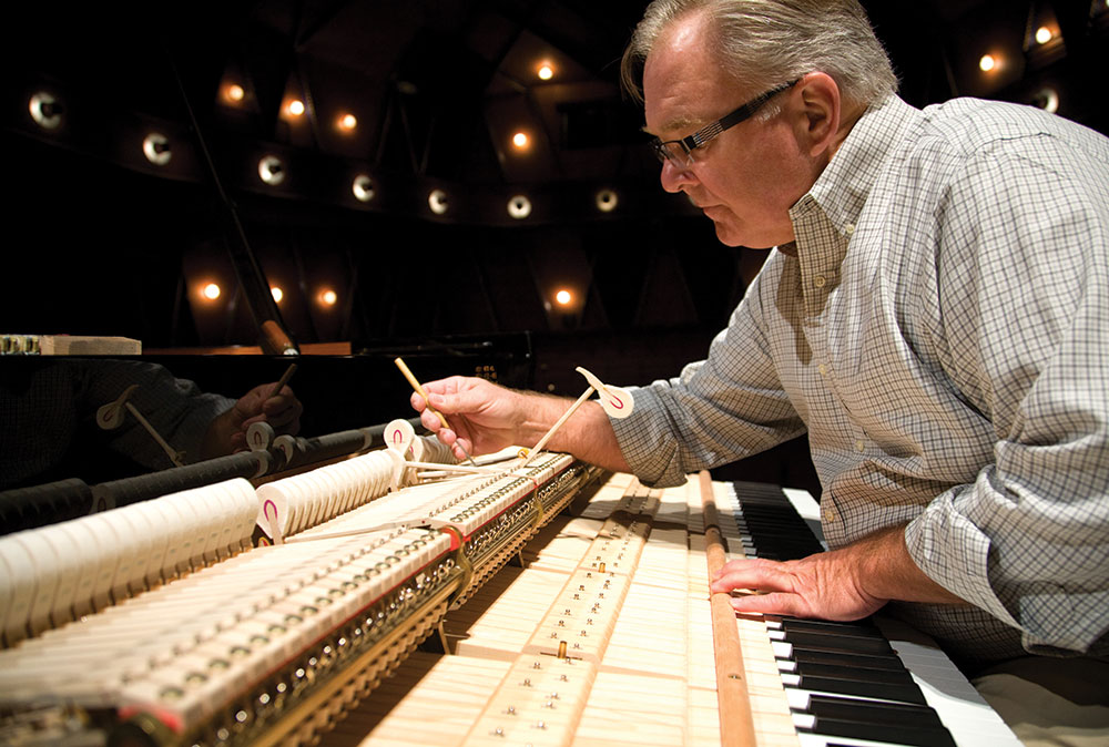 Striking a chord . . . piano technician James Williams